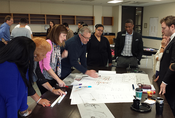 Students, staff, architects and interior designers explore options during a design charrette.